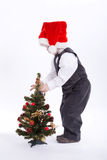 Boy with santa hat decorate christmas tree Stock Image