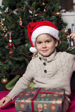 Boy with Santa hat. Four years old boy with Santa hat holding a bell Royalty Free Stock Image