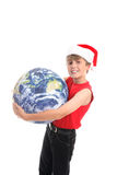 Boy in Santa hat with globe Stock Image