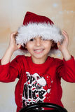 Boy in Santa hat. Happy little boy in red Santa hat Stock Photo