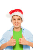 Boy in Santa hat holding thumbs up Stock Images