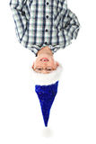 Boy with santa hat overhead on white smiling Royalty Free Stock Images