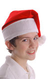 Boy in Santa hat side. Photo of a boy in Santa hat side Stock Images