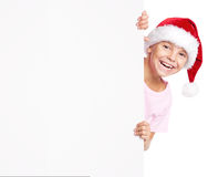 Boy in Santa hat with white blank Stock Images