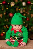 Boy in Santas elf costume Royalty Free Stock Images