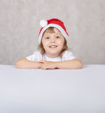 Boy in Santas hat Stock Image