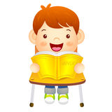 The boy sat down on the chair. Is reading a book on the desk. Ed Royalty Free Stock Image