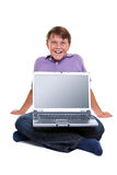 Boy sat with laptop on his legs blank screen Royalty Free Stock Photography