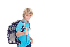 Boy with satchel and thumb up in front of white background. Blond boy with satchel and thumb up in front of white background Royalty Free Stock Photography