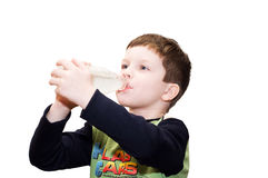 The boy satisfying thirst Stock Image