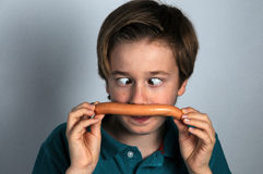 Boy with sausage Stock Image