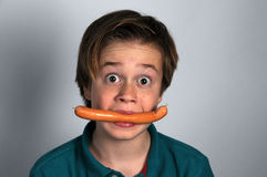 Boy with sausage Royalty Free Stock Images