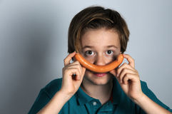 Boy with sausage Royalty Free Stock Photography