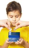 Boy saving money Stock Images