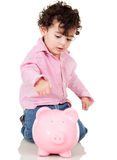 Boy saving money Stock Image