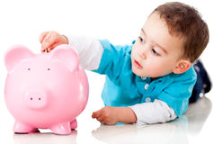 Boy saving money Royalty Free Stock Photos