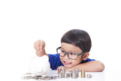 Boy saving money Royalty Free Stock Photo