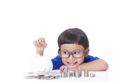 Boy saving money Royalty Free Stock Images