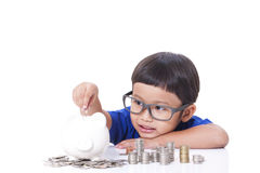 Boy saving money Royalty Free Stock Image
