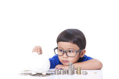 Boy saving money Stock Photo