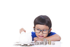 Boy saving money Stock Photography