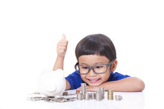 Boy saving money Royalty Free Stock Photos