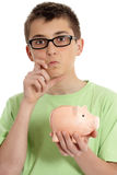 Boy savings dilemma Stock Photography
