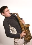 Boy with Saxophone. Boy playing the saxophone Stock Photo