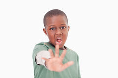 Boy saying stop with his hand Royalty Free Stock Photography