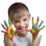 Boy scares their hands stained with paint Stock Photos