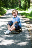 Boy with a scateboard Stock Images