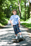 Boy with a scateboard Royalty Free Stock Photos