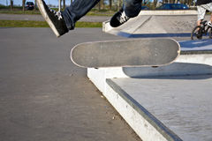 Boy with scateboard is going airborne Stock Photography