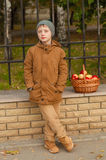 Boy with a school backpack with a basket of apples Royalty Free Stock Photo