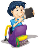 A boy in the school bag Stock Image