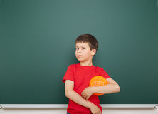 Boy and the school board Stock Image
