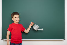 Boy and the school board Royalty Free Stock Images