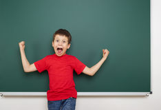 Boy and the school board Stock Images