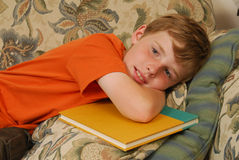 Boy with a school book resting Royalty Free Stock Photography