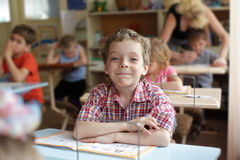 Boy in school class Royalty Free Stock Image