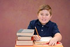 Boy at School Desk Stock Photo