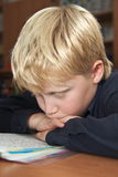 Boy at school at a lesson Stock Image