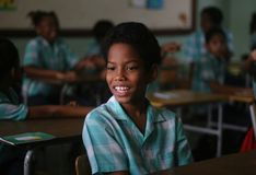 Boy in school, in Paramaribo