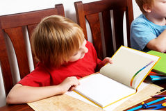 The boy of school return which note book Stock Image