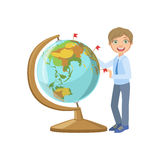 Boy In School Uniform With Giant Globe Stock Images