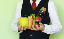 Boy in school uniform and lunch box with sandwich and fruits. Healthy eating Royalty Free Stock Photography