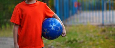 Boy schoolboy playing football on the Playground stock photos