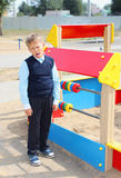 Boy is a pupil on a children`s playground. A boy, a schoolboy, a student walks on the playground in the park Royalty Free Stock Photo