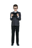 Boy schoolboy wearing glasses. Smart boy with a tablet in hands. The concept of modern education. Stock Photo