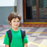 Boy on schoolyard in elementary. Boy standing on schoolyard in an elementary school Royalty Free Stock Images
